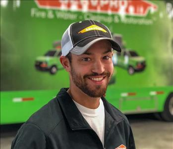 man in front of a SERVPRO trailer